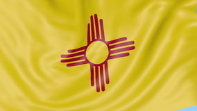 Waving flag of New Mexico state against blue sky. Seamless loop 4K clip. ProRes stock video