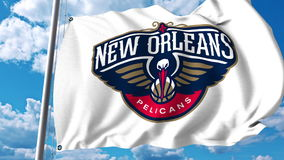 Waving flag with New Orleans Pelicans professional team logo. Editorial 3D rendering. Waving flag with New Orleans Pelicans professional team logo. Editorial 3D Royalty Free Stock Photos