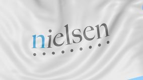 Waving flag with Nielsen Holdings logo. Seamles loop 4K editorial animation
