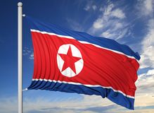 Waving flag of North Korea on flagpole Royalty Free Stock Photography