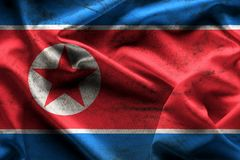 Waving flag of the North Korea texture and background. royalty free illustration