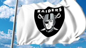 Waving flag with Oakland Raiders professional team logo. Editorial 3D rendering. Waving flag with Oakland Raiders professional team logo. Editorial 3D Royalty Free Stock Images