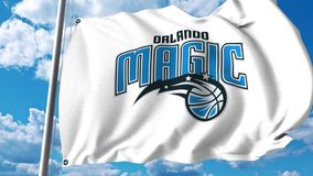 Waving flag with Orlando Magic professional team logo. 4K editorial clip