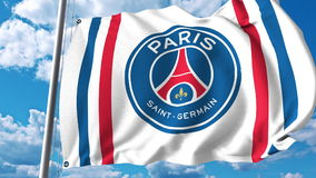 Waving flag with Paris Saint Germain football team logo. Editorial 3D rendering. Waving flag with Paris Saint Germain football team logo. Editorial 3D Stock Images