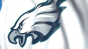 Waving flag with Philadelphia Eagles team logo, close-up. Editorial loopable 3D animation