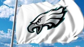 Waving flag with Philadelphia Eagles professional team logo. 4K editorial clip