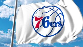 Waving flag with Philadelphia 76Ers professional team logo. 4K editorial clip stock illustration