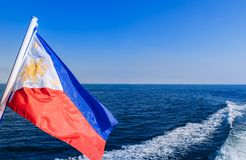 Waving flag of philippines on ferry boat royalty free stock photography