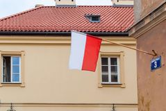 Waving flag of Poland in the wall in Warsaw Stock Images