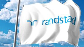 Waving flag with Randstad Holding logo against clouds and sky. Editorial 3D rendering Royalty Free Stock Images