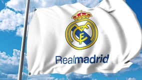 Waving flag with Real Madrid football team logo. Editorial 3D rendering Stock Photos