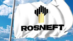 Waving flag with Rosneft logo against clouds and sky. 4K editorial animation. Waving flag with Rosneft logo against clouds and sky stock video