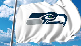 Waving flag with Seattle Seahawks professional team logo. Editorial 3D rendering Royalty Free Stock Photo