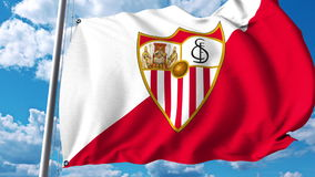 Waving flag with Sevilla football team logo. Editorial 3D rendering. Waving flag with Sevilla football team logo. Editorial 3D Royalty Free Stock Image