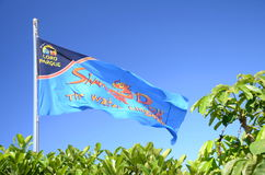 Waving flag of Siam Park against blue sky in Costa Adeje on Tenerife Stock Photo