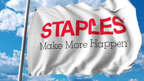 Waving flag with Staples Inc logo. Editoial 3D rendering Royalty Free Stock Photo