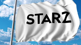 Waving flag with Starz logo. Editoial 3D rendering Royalty Free Stock Photography