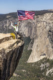 Waving a flag on the summit. Royalty Free Stock Photography