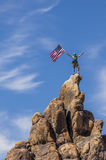 Waving a flag on the summit. Stock Image