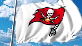Waving flag with Tampa Bay Buccaneers professional team logo. Editorial 3D rendering Stock Images