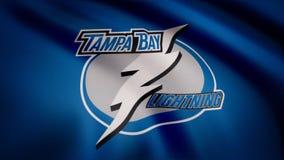 USA - NEW YORK, 12 August 2018: Waving flag with Tampa Bay Lightning NHL hockey team logo. Close-up of waving flag with. Waving flag with Tampa Bay Lightning NHL royalty free stock photo