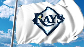 Waving flag with Tampa Bay Rays professional team logo. Editorial 3D rendering Stock Photography