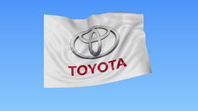 Waving flag with Toyota logo, seamless loop, blue background. Editorial animation. 4K ProRes, alpha. Flapping flag with Toyota logo, seamless looping against royalty free illustration