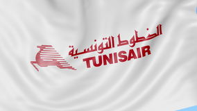 Waving flag of Tunisair against blue sky background, seamless loop. Editorial 4K animation. ProRes royalty free illustration
