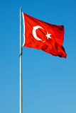 Waving flag of Turkey. Under sunny blue sky Stock Photos
