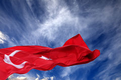 Waving flag of Turkey against blue sky Stock Photo