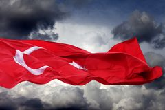 Waving flag of Turkey. Against storm clouds stock images