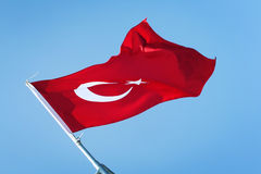 Waving flag of Turkey. Red Turkish flag on the blue sky. Royalty Free Stock Photo