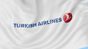 Waving flag of Turkish Airlines against blue sky background, seamless loop. Editorial 4K animation stock video footage