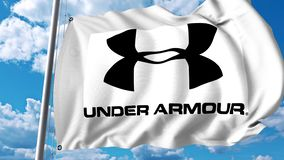 Waving flag with Under Armour logo. 4K editorial animation. Waving flag with Under Armour logo. 4K editorial clip royalty free illustration