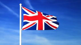 Waving flag of United Kingdom on the blue sky background. 3D rendered stock video footage