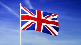 Waving flag of United Kingdom on the blue sky background stock video footage
