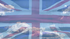 United Kingdom sky flag. Waving flag of United Kingdom of Great Britain and Northern Ireland in blue sky time lapse stock video footage