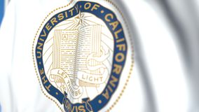 Waving flag with University of California Davis emblem, close-up. Editorial loopable 3D animation. Waving flag with University of California Davis emblem stock video footage