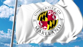 Waving flag with University of Maryland College Park emblem. 4K editorial clip
