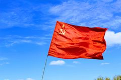 Waving flag of the USSR against the blue sky Stock Images