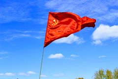 Waving flag of the USSR against the blue sky Royalty Free Stock Image