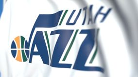 Waving flag with Utah Jazz team logo, close-up. Editorial loopable 3D animation. Waving flag with Utah Jazz professional team logo. Editorial 3D vector illustration