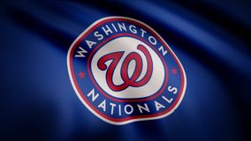 Waving flag with Washington Nationals professional team logo. Close-up of waving flag with Baseball Washington Nationals. Club logo, seamless loop. Editorial royalty free stock image