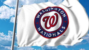 Waving flag with Washington Nationals professional team logo. Editorial 3D rendering Royalty Free Stock Photos