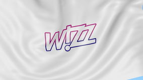 Waving flag of Wizz Air against blue sky background, seamless loop. Editorial 4K animation stock video