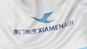 Waving flag of XiamenAir against blue sky background, seamless loop. Editorial 4K animation stock video