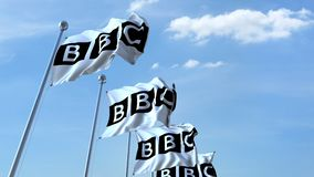 Waving flags with BBC logo against sky, seamless loop. 4K editorial animation. Waving flags with BBC logo against sky, seamless loop. 4K editorial clip stock video