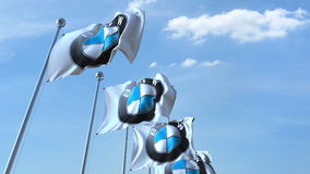 Waving flags with Bmw logo against sky, editorial 3D rendering Stock Photos