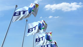 Waving flags with British Telecom BT logo against sky, editorial 3D rendering. Waving flags with British Telecom BT logo against sky, editorial 3D Royalty Free Stock Photos