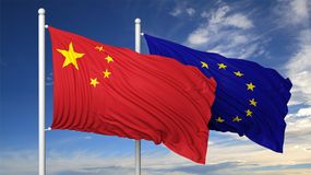Waving flags of China and EU on flagpole Royalty Free Stock Images